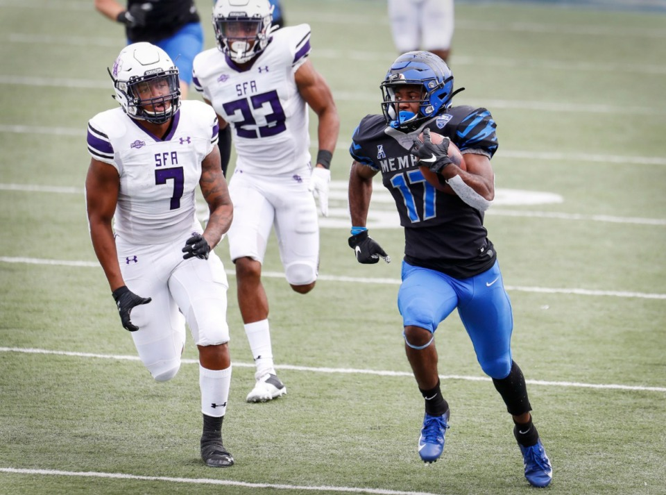 <strong>Memphis running back Kylan Watkins (right) runs by the Stephen F. Austin defense during action on Saturday, Nov. 21, 2020.</strong> (Mark Weber/The Daily Memphian)