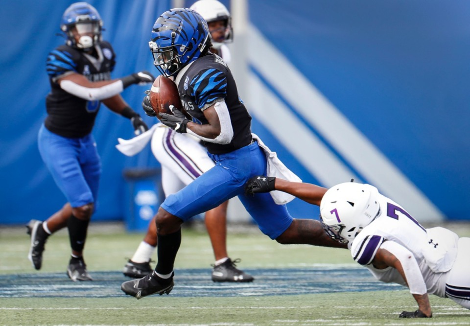 <strong>Memphis receiver Tahj Washington (left) runs by Stephen F. Austin defender Jeremiah Davis (right) on his way to a touchdown during action on Saturday, Nov. 21, 2020.</strong> (Mark Weber/The Daily Memphian)