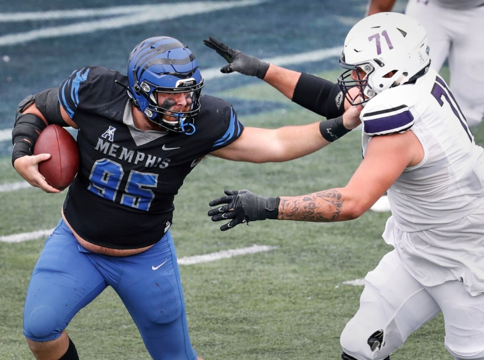<strong>Memphis defensive lineman John Cartwright (left) fights off a tackle by Stephen F. Austin lineman Zach Ingram (right) after grab an interception during action on Saturday, Nov. 21, 2020.</strong> (Mark Weber/The Daily Memphian)