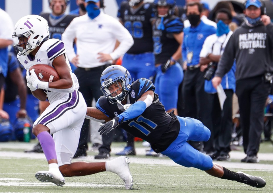 <strong>Memphis defender Sylvonta Oliver (right) can not bring down Stephen F. Austin receiver Jeremiah Miller (left) during action on Saturday, Nov. 21, 2020.</strong> (Mark Weber/The Daily Memphian)