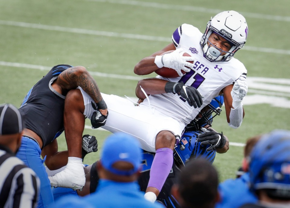 <strong>Stephen F. Austin receiver Jeremiah Miller (top) is taken down by the Memphis defense during action on Saturday, Nov. 21, 2020.</strong> (Mark Weber/The Daily Memphian)