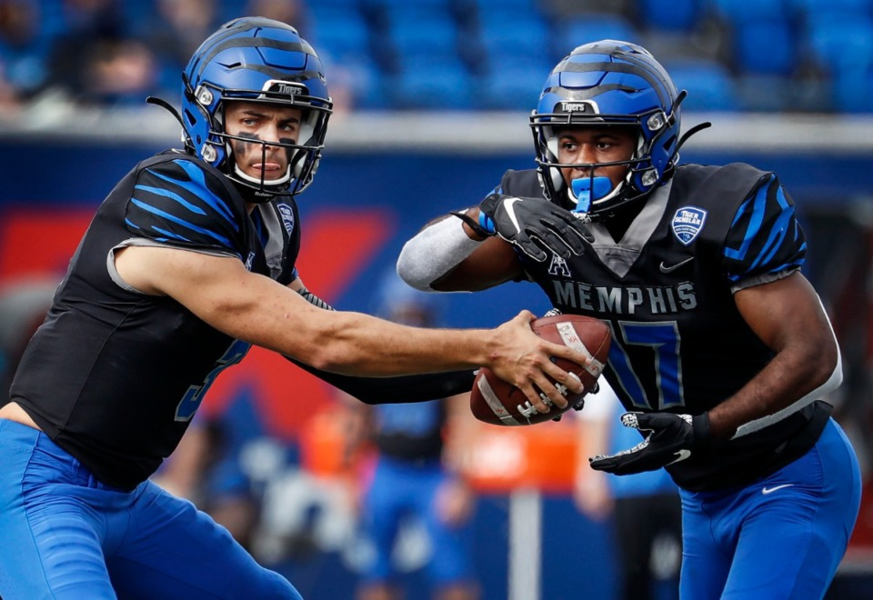 <strong>Memphis quarterback Brady White (left) hands the ball to running back Kylan Watkins (right) against the Stephen F. Austin defense during action on Saturday, Nov. 21, 2020.</strong> (Mark Weber/The Daily Memphian)