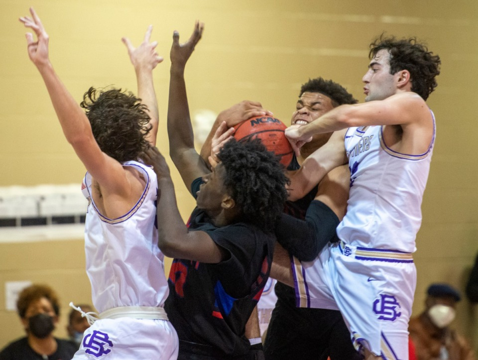 <strong>CBHS's Colin Scifres (22) and Hunter Pratt (32) battle Bartlett High School's Rashad Williams (20) and Calvin Jennings (0) for the rebound in Saturday's early season contest at CBHS.</strong> (Greg Campbell/Special to The Daily Memphian)