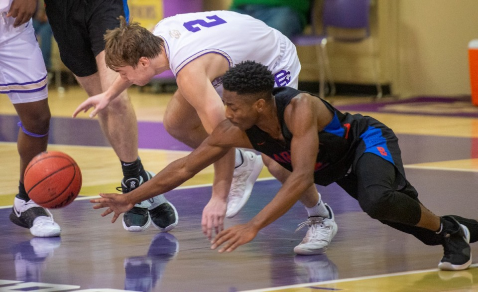 <strong>CBHS's Eli Federman (2) and Bartlett's Will Farris (2) battle for a loose ball in the first quarter of the game at CBHS Saturday, Nov. 21, 2020.</strong> (Greg Campbell/Special to The Daily Memphian)