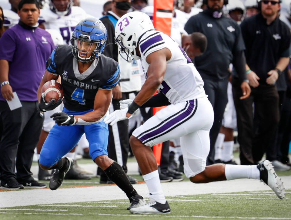 <strong>Memphis receiver Calvin Austin III (left) makes a first down catch against Stephen F. Austin defender Bruce Harmon (right) during action on Saturday, Nov. 21, 2020.</strong> (Mark Weber/The Daily Memphian)