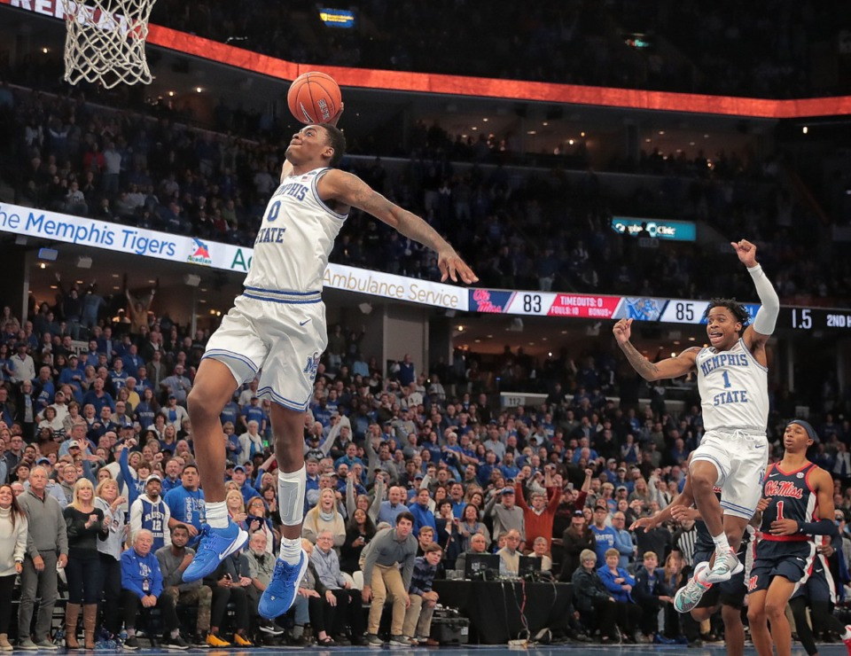 <strong>University of Memphis forward DJ Jeffries makes a breakaway dunk as Tyler Harris (1) celebrates in the final seconds of the Tigers' game on Nov. 23, 2019, against Mississippi at FedExForum. The Dec. 5, 2020 Memphis-Ole Miss game has been canceled due to COVID.</strong> (Jim Weber/Daily Memphian file)