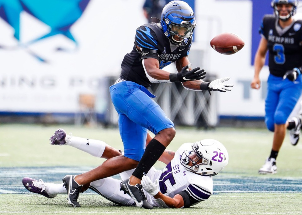 <strong>Memphis receiver Javon Ivory can not hang onto a catch while being hit by Stephen F. Austin defender Tkai Lloyd during action on Saturday, Nov. 21, 2020</strong>. (Mark Weber/Daily Memphian)