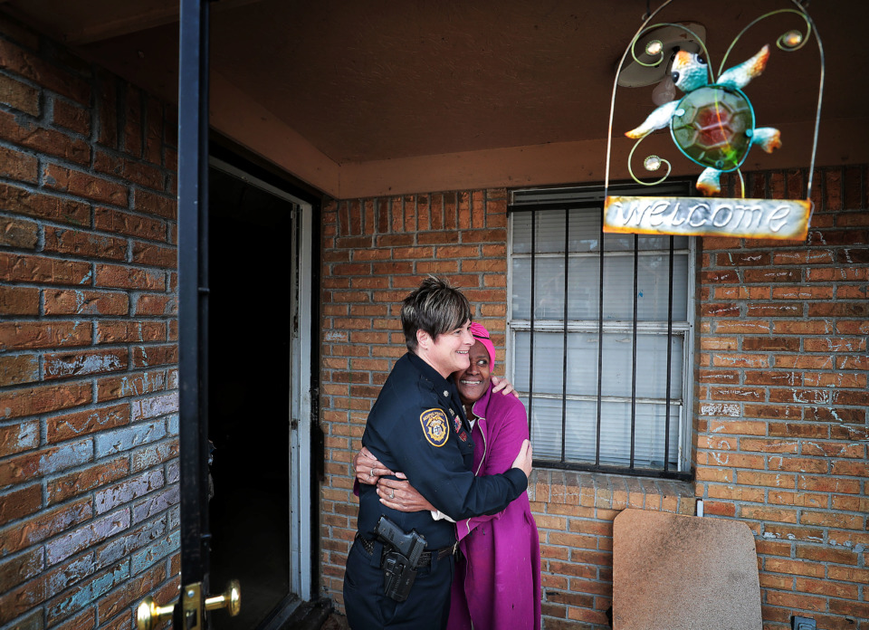 <strong>Burglary victim Sylvia Crump, 67, embraces Memphis Police Lt. Col. Dana Sampietro as Crump thanks officers and Boll Weevils who came to her house on Wednesday, Dec. 19, to replace Christmas gifts that were stolen from her home.</strong> (Jim Weber/Daily Memphian)