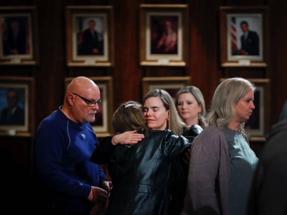 <strong>Shelby County District Attorney Amy Weirich (middle) hugs family members of homicide victims during 9th annual Season of Remembrance memorial event Monday, Dec. 2, 2019 at City Hall.</strong> (Mark Weber/Daily Memphian file)
