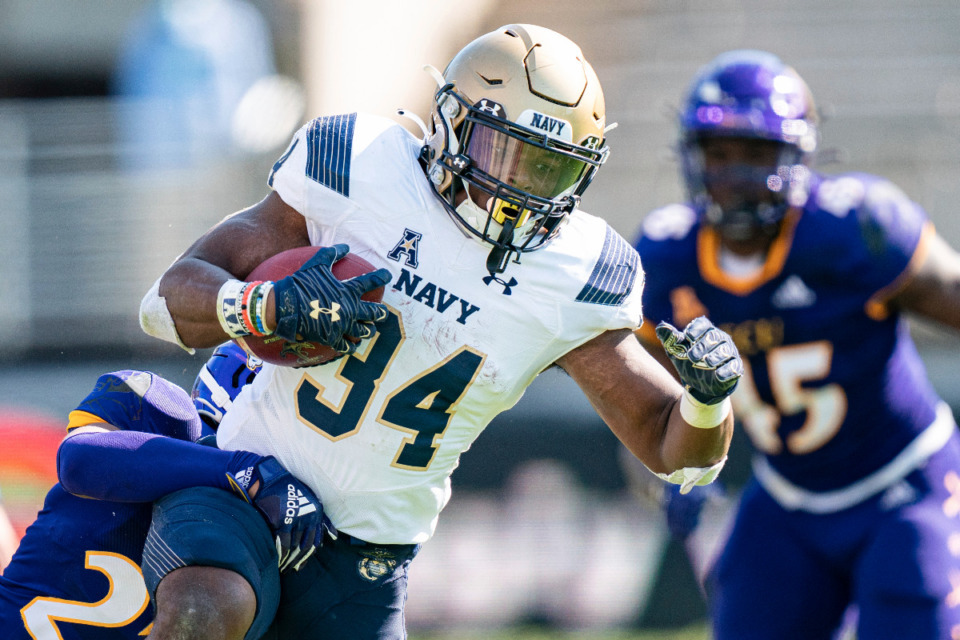 <strong>Navy fullback Jamale Carothers (34) is one of the keys to the Midshipmen&rsquo;s triple option rushing attack that the Tigers have been preparing for since preseason practice began.</strong> (AP Photo/Jacob Kupferman)