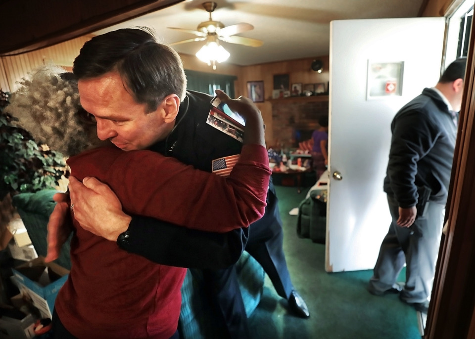 <strong>Burglary victim Patricia Byers embraces Memphis Police Deputy Chief Michael Shearin as she thanks Memphis Police officers and Boll Weevils who showed up at her home on Wednesday, Dec. 19, with Christmas gifts to replace presents that were stolen from her home.</strong> (Jim Weber/Daily Memphian)