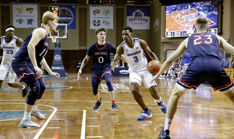 <strong>Landers Nolley II (3) of the Memphis Tigers drives to the basket against Logan Johnson (0) of the St. Mary's Gaels during the Bad Boy Mowers Crossover Classic at the Sanford Pentagon in Sioux Falls, S.D., on Thursday, Nov. 25.&nbsp;</strong>(Richard Carlson/inertia)