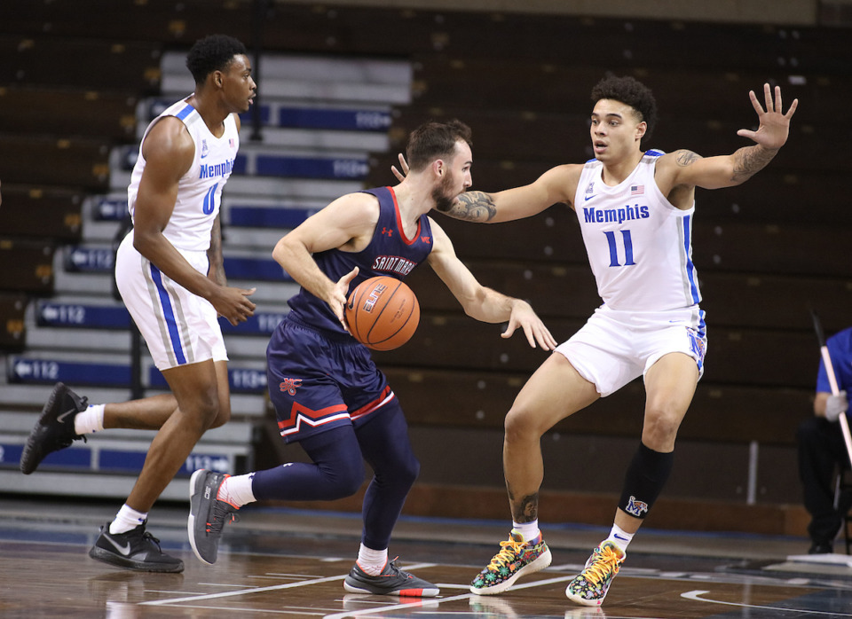 <strong>Saint Mary&rsquo;s Tommy Kuhse (12) looks to drive past the defense of the Memphis Tigers&rsquo; Lester Quinones (11) during the Bad Boy Mowers Crossover Classic in Sioux Falls, S.D.</strong> (Photo by Richard Carlson/Inertia)