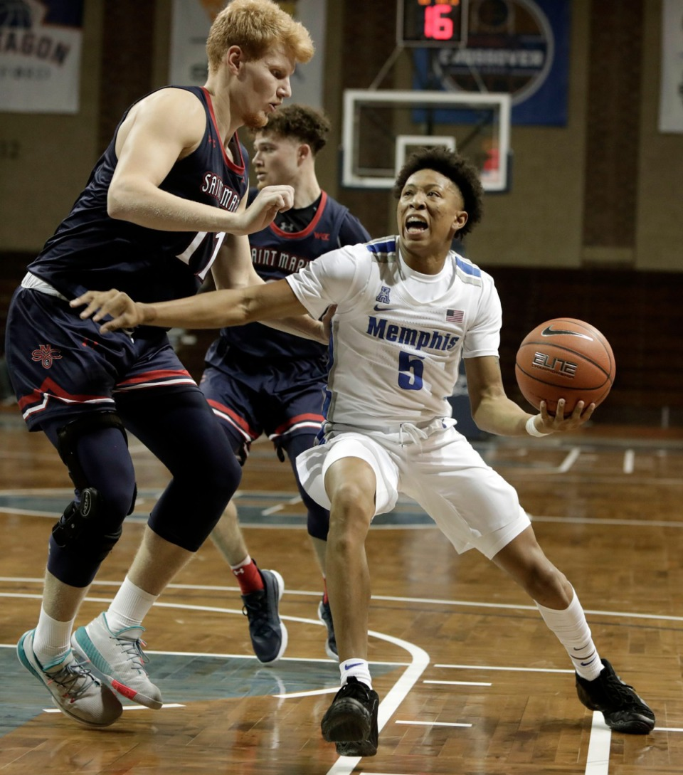<strong>Memphis Tigers&rsquo; Boogie Ellis (5) drives to the basket against Saint Mary's defenders during the Bad Boy Mowers Crossover Classic at the Sanford Pentagon in Sioux Falls, S.D., on Thursday, Nov. 25. Memphis won 73-56.</strong> (Photo by Richard Carlson/Inertia)