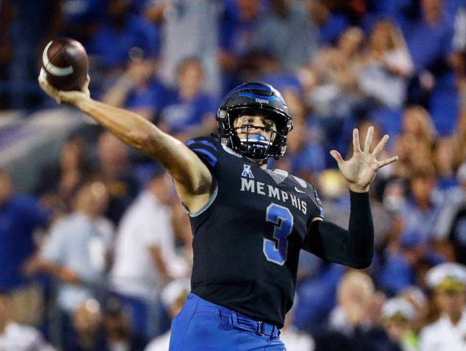 <strong>Memphis quarterback Brady White makes a throw against the Navy defense during action in their college football game at the Liberty Bowl Memorial Stadium Thursday, Sept. 26, 2019.</strong> (Mark Weber/Daily Memphian file)