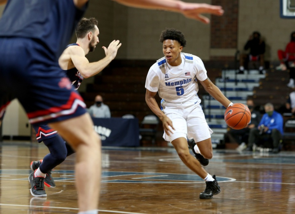 <strong>Boogie Ellis (5) of the Memphis Tigers drives to the basket against Tommy Kuhse (12) of the Saint Mary's Gaels during the Bad Boy Mowers Crossover Classic at the Sanford Pentagon in Sioux Falls, SD.</strong> (Photo by Dave Eggen/Inertia)