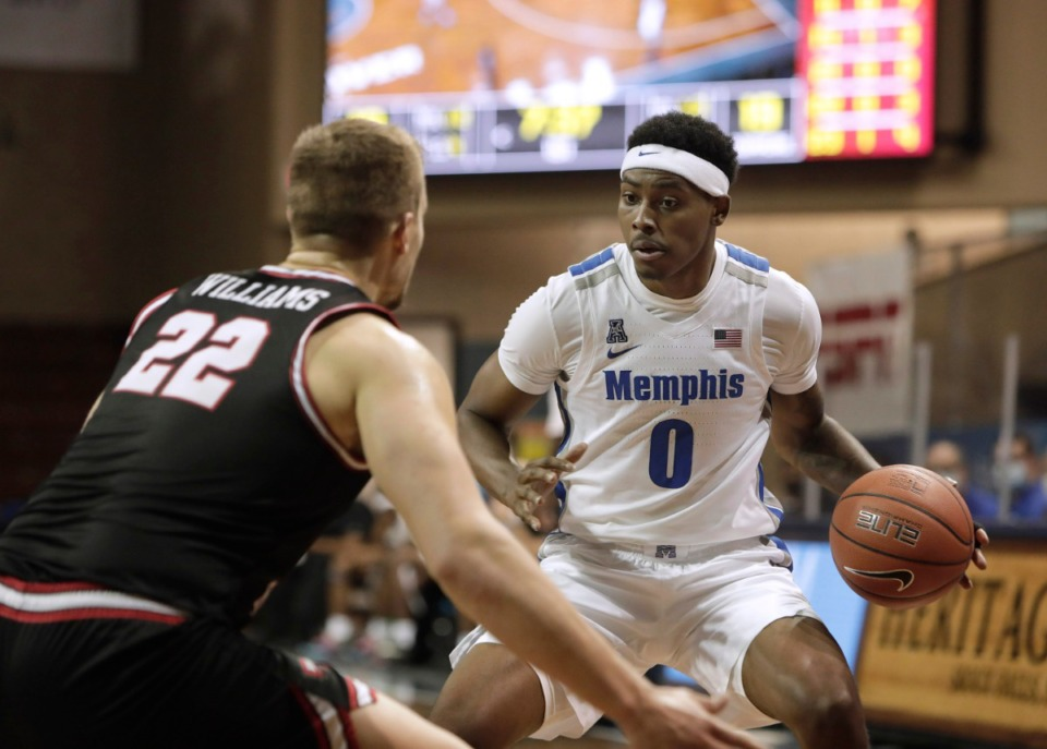 <strong>Memphis Tigers&rsquo; D.J. Jeffries drives toward Western Kentucky&rsquo;s Carson Williams during the Bad Boy Mowers Crossover Classic in Sioux Falls, S.D., on Thursday, Nov. 26.</strong> (Photo by Richard Carlson/Inertia)