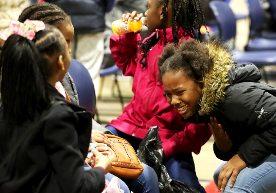 <strong>Saniya Richardson (right) and her friends attend a toy drive hosted by the University of Memphis and the City of Memphis.</strong> (Houston Cofield/Daily Memphian)