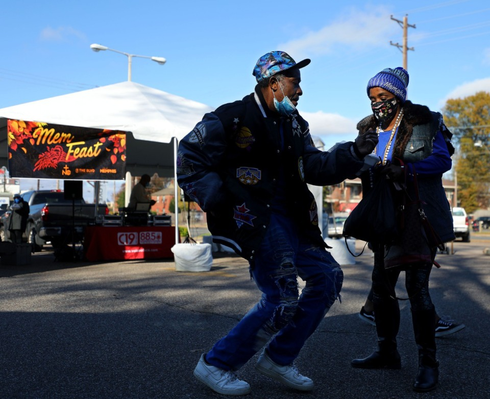 <strong>Larry Werby and Lena Lewis dance after getting a Thanksgiving meal at Mississippi Boulevard Christian Church on Thursday, Nov. 26. Due to the coronavirus pandemic, this year&rsquo;s MemFeast was set up at six church parking lots across the city, and meals were distributed in to-go containers.</strong> (Patrick Lantrip/Daily Memphian)