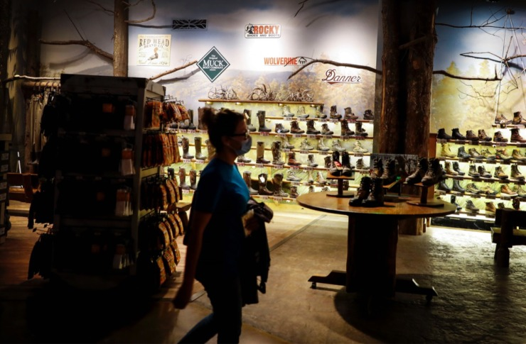 <strong>A customer walks by the boot collection at the Bass Pro Shops at The Pyramid on Tuesday, Nov. 17, 2020</strong>. (Mark Weber/The Daily Memphian)