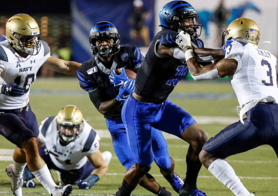 <strong>When the Tigers faced the Midshipmen Sept. 26, 2019, Memphis receiver Kylan Watkins (middle) scrambled past the Navy defense at Liberty Bowl Memorial Stadium.</strong> (Mark Weber/Daily Memphian)