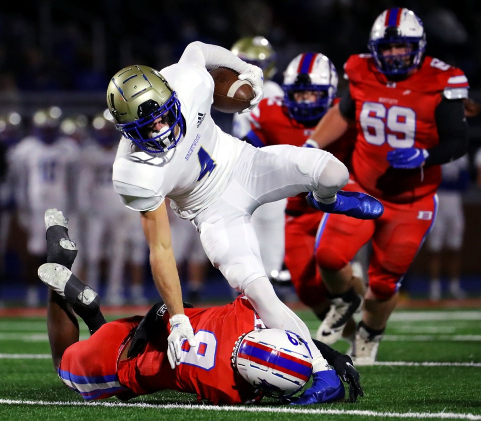 <strong>Bartlett High School safety Thomas Jones (9) bring down Brentwood High School receiver Walker Merrill (4) during a Nov. 27 game at Bartlett High School.</strong> (Patrick Lantrip/Daily Memphian)