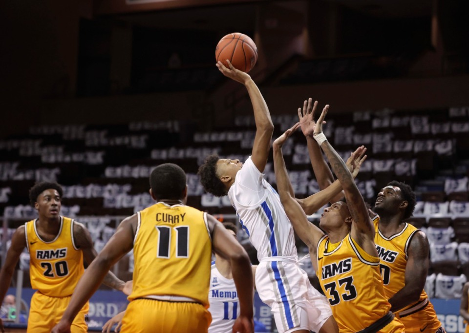 <strong>Boogie Ellis of the Memphis Tigers shoots over Josh Banks (33) of the VCU Rams during the Bad Boy Mowers Crossover Classic at the Sanford Pentagon in Sioux Falls, S.D. on Friday, Nov. 27.</strong> (Richard Carlson/Inertia)