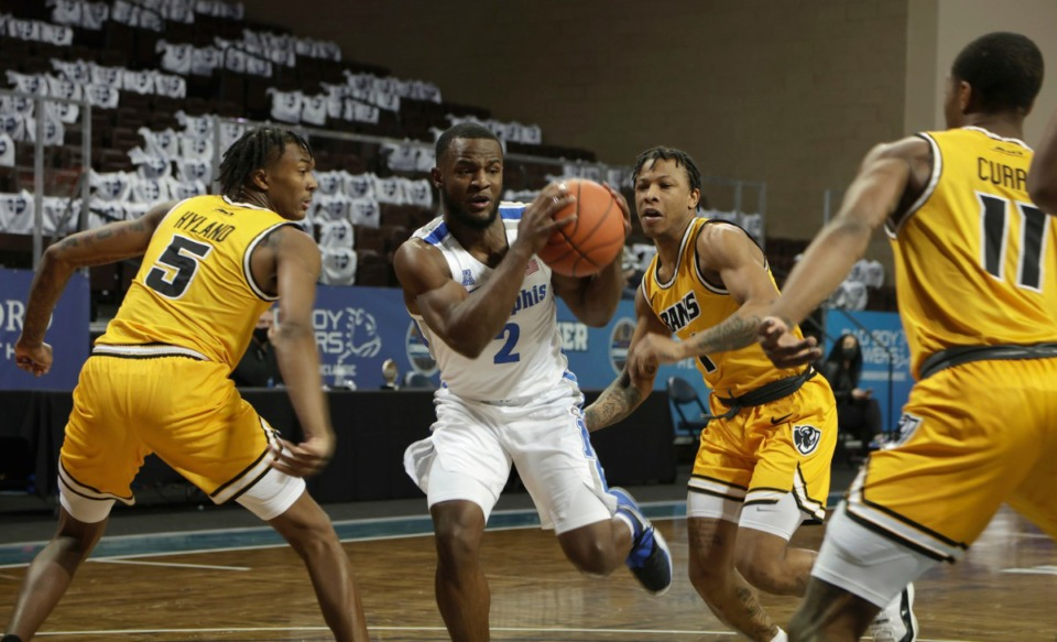 <strong>Alex Lomax (2) of the Memphis Tigers drives into Virginia Commonwealth defenders during the Bad Boy Mowers Crossover Classic Friday, Nov. 27 at the Sanford Pentagon in Sioux Falls, S.D.</strong> (Richard Carlson/Inertia)