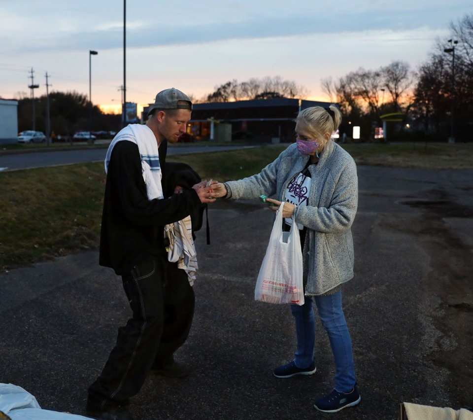 <strong>Kathy Shoffner, affectionately known as&nbsp;&ldquo;the cigarette lady,&rdquo; hands out loose cigarettes to people who attend the weekly needle exchange held by A Betor Way.</strong> (Patrick Lantrip/Daily Memphian)