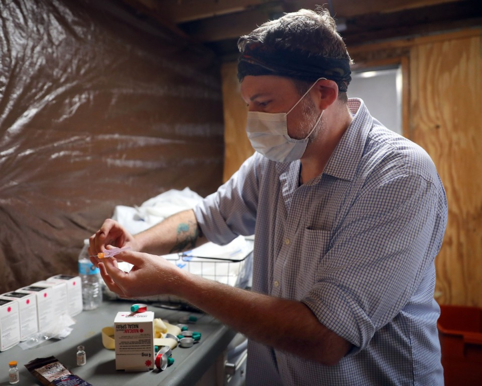 <strong>Aaron Mittelmeier prepares a Narcan kit during a needle exchange event held by A Betor Way on Friday, Nov. 27.</strong> (Patrick Lantrip/Daily Memphian)