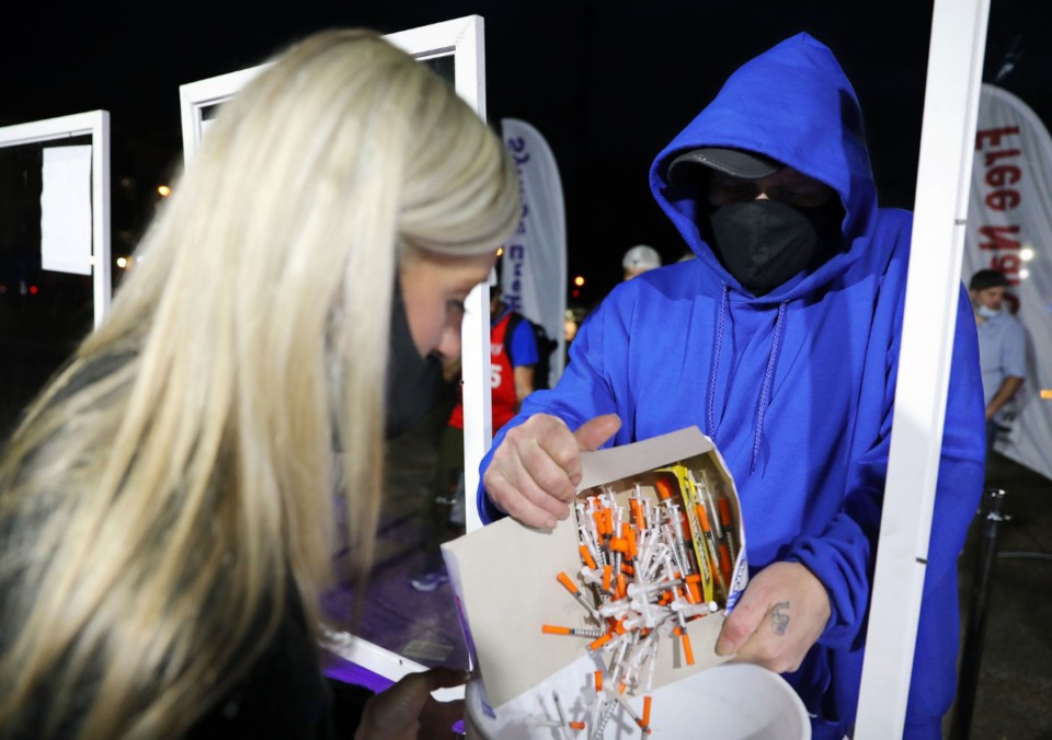 <strong>Mandie Shoffner helps a man exchange his dirty needles during a needle exchange event on Friday, Nov. 27.</strong> (Patrick Lantrip/Daily Memphian)