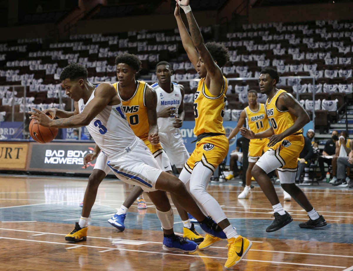 <strong>Landers Nolley II 3 of the Memphis Tigers falls away from Virginia Commonwealth defenders during the Bad Boy Mowers Crossover Classic at the Sanford Pentagon in Sioux Falls, S.D.</strong> (Richard Carlson/Inertia)