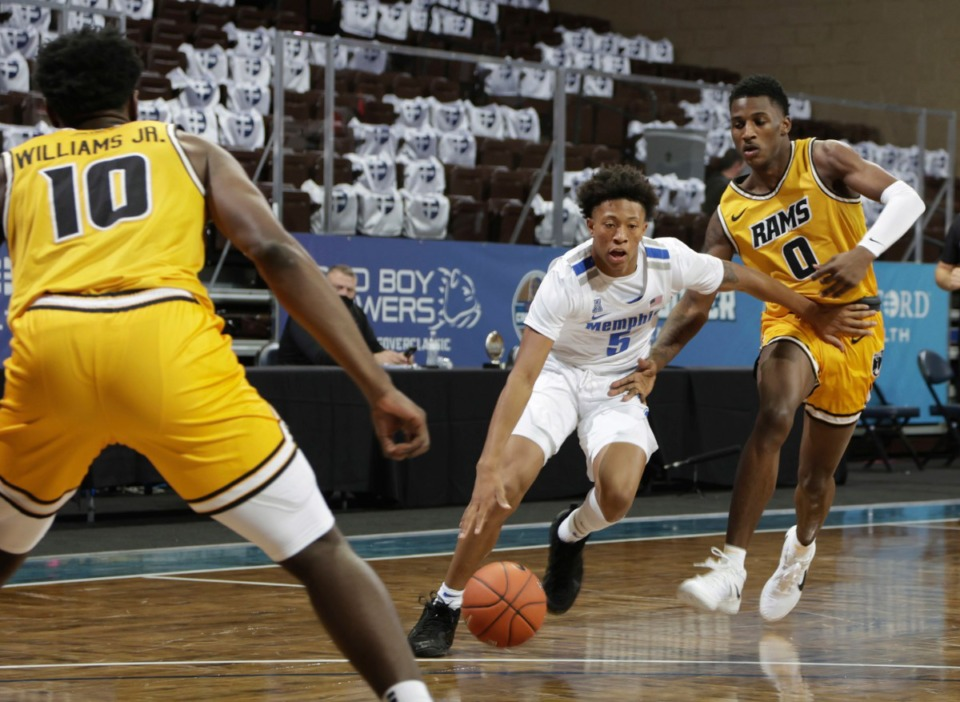 <strong>Boogie Ellis of the Memphis Tigers drives past Jamir Watkins (0) of the Virginia Commonwealth Rams during the Bad Boy Mowers Crossover Classic at the Sanford Pentagon in Sioux Falls, S.D.</strong> (Richard Carlson/Inertia)