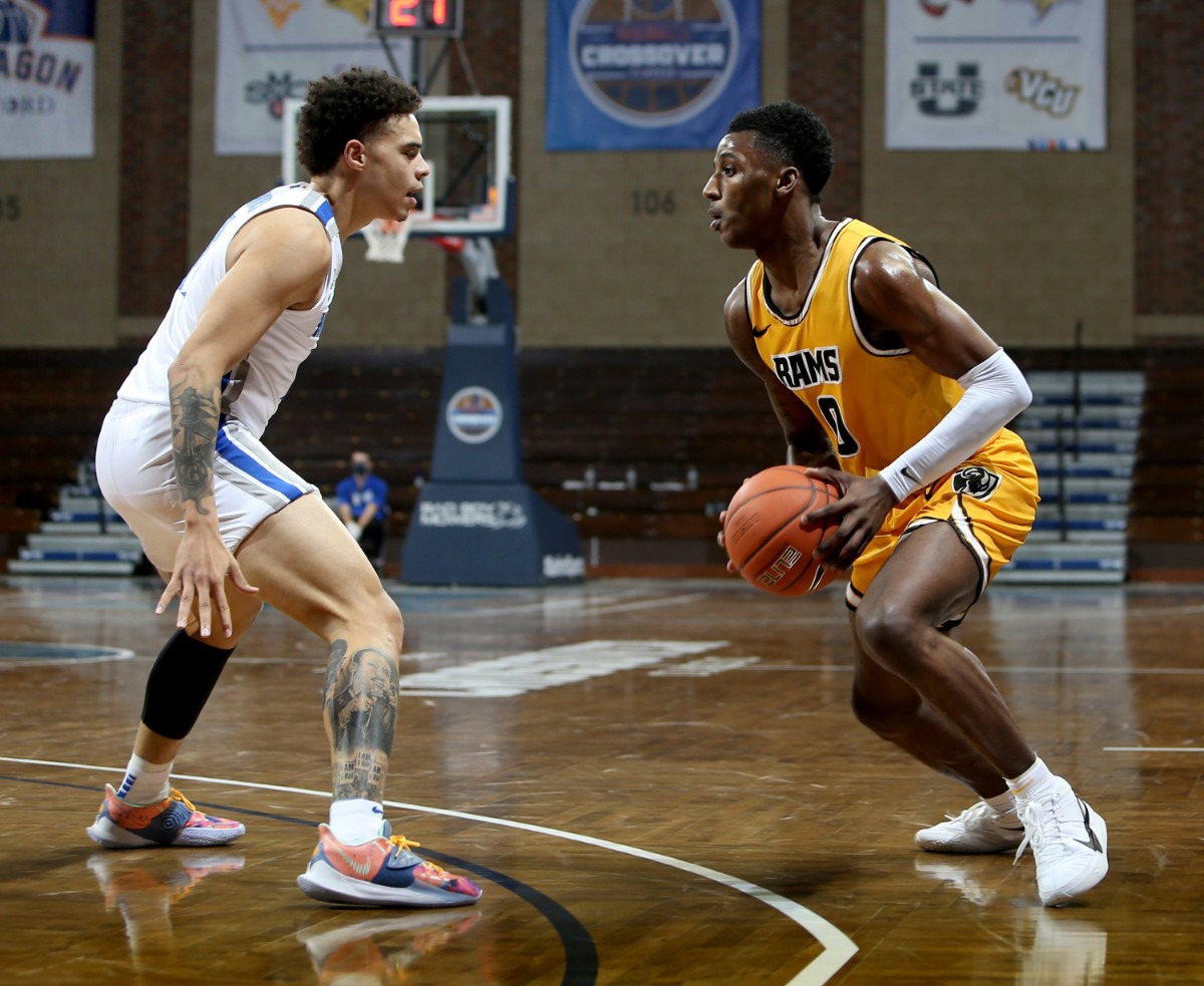 <strong>Lester Quinones of the Memphis Tigers blocks a drive by Jamir Watkins of the VCU Rams Friday, Nov. 27 during the Bad Boy Mowers Crossover Classic at the Sanford Pentagon in Sioux Falls, S.D.</strong> (Dave Eggen/Inertia)