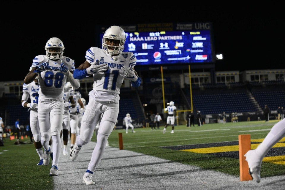 <strong>Drake Day (11) and Tyce Daniel (88) run onto the field as the Tigers face the Midshipmen Saturday, Nov. 28 in Annapolis, Md.</strong> (Carolyn Andros/University of Memphis)