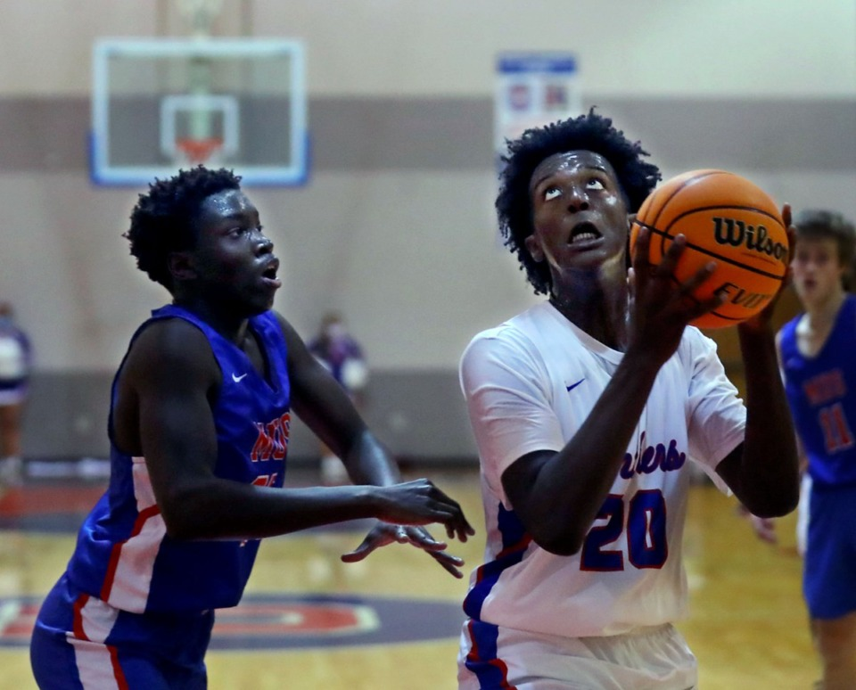 <strong>Bartlett High School forward Rashad Williams (20) goes up for a layup during a Nov. 28, 2020 game against Memphis University School.</strong> (Patrick Lantrip/Daily Memphian)