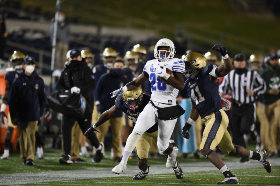 <strong>Running back Asa Martin scoots past Navy defense Saturday, Nov. 28, 2020 as the Tigers face the Midshipmen at Annapolis, Maryland.</strong> (Carolyn Andros/University of Memphis)