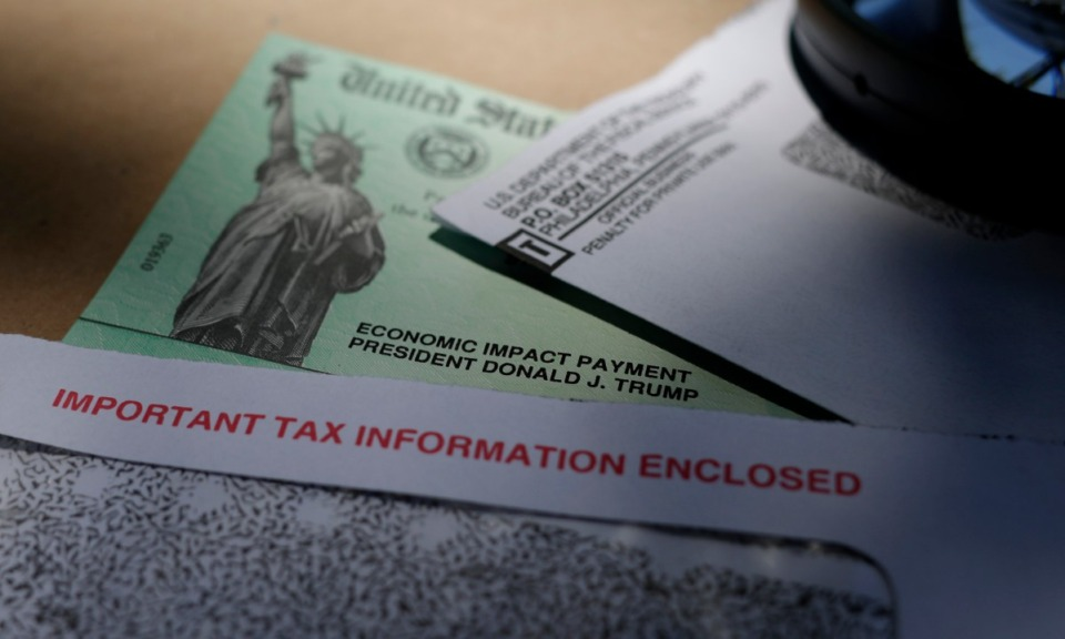 <strong>The $1,200 stimulus checks that many Americans received will not be counted as taxable income. But unemployment pay is taxable, experts say.</strong> (Eric Gay/AP file)