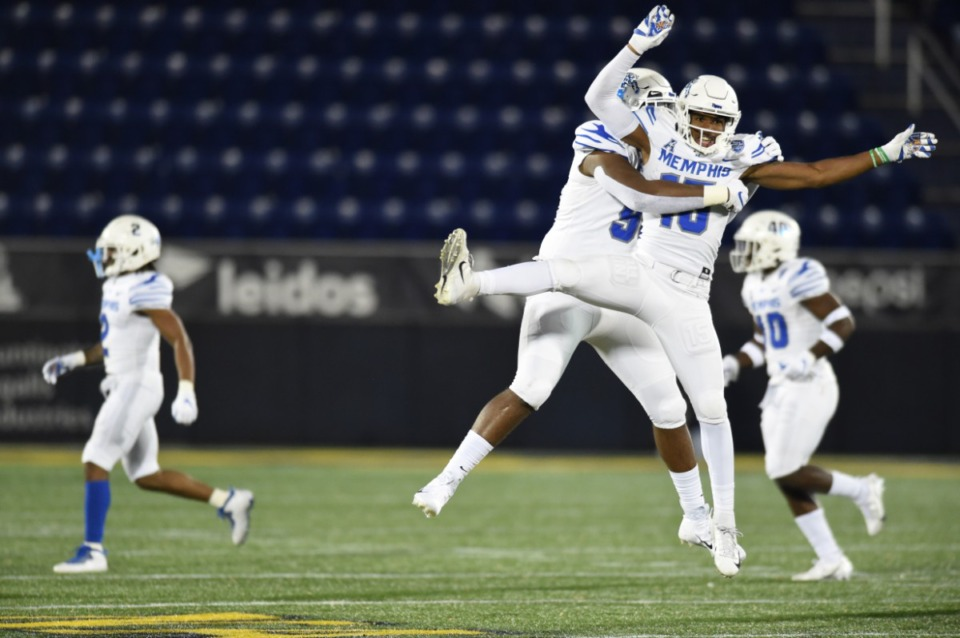 <strong>Defensive backs John Broussard Jr. (9) and Quindell Johnson (15) celebrate.</strong> (Carolyn Andros/University of Memphis)