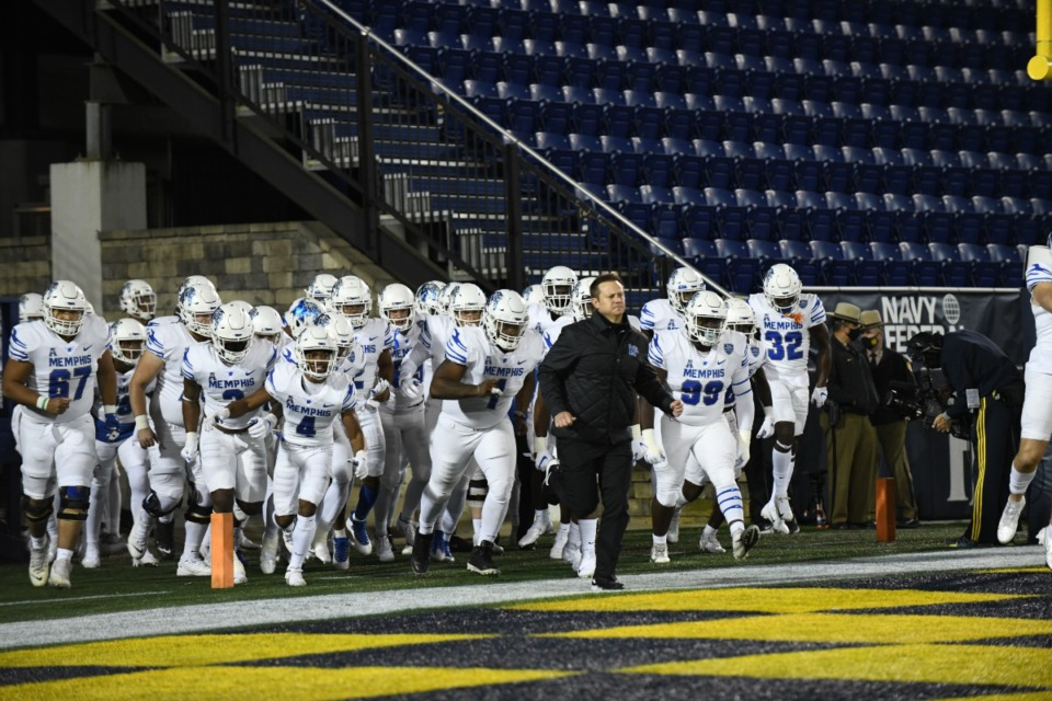 <strong>Coach Ryan Silverfield&nbsp;&mdash; running onto the field with&nbsp;the Tigers&nbsp; Saturday, Nov. 28 in Annapolis, MD&nbsp;&mdash; said it took all 11 defensive players on the field to shut down the Midshipmen. The Tigers won, 10-7.</strong> (Carolyn Andros/University of Memphis)
