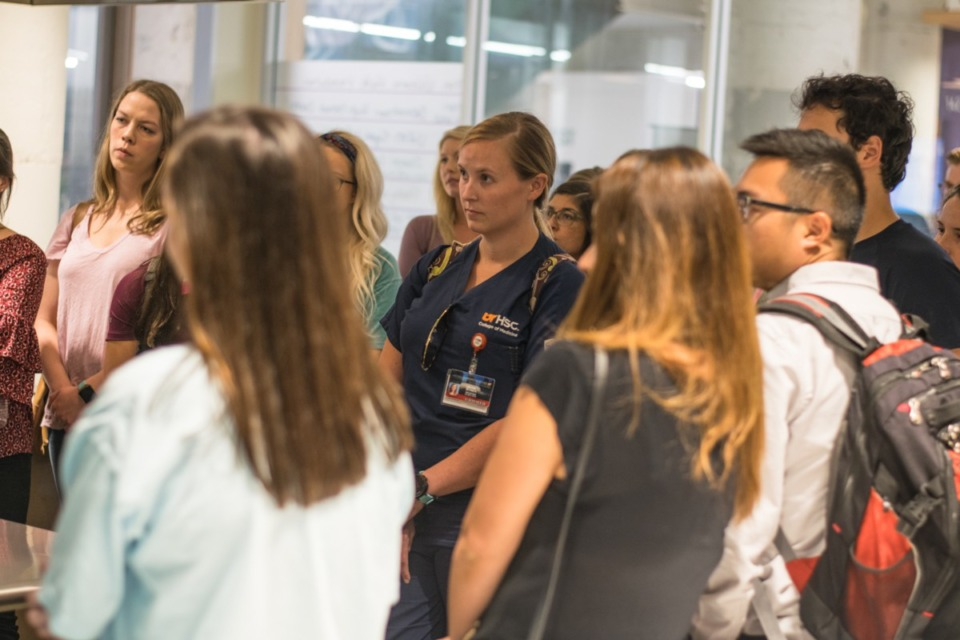 <strong>Students listen closely to Dr. Scott Morris during a (pre-pandemic) tour of Church Health at Crosstown Concourse. Students may be tapped to help fill the growing staffing needs of hospitals and vaccine distribution in the coming weeks.</strong> (Daily Memphian file)