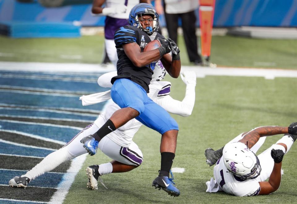 <strong>Memphis running back Asa Martin (middle) runs past the Stephen F. Austin defense for a touchdown on Nov. 21, 2020.</strong> (Mark Weber/The Daily Memphian)