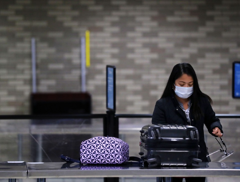 <strong>A passenger prepares her baggage to be scanned by the TSA at Memphis International Airport on Wednesday, Dec. 2.</strong> (Patrick Lantrip/Daily Memphian)