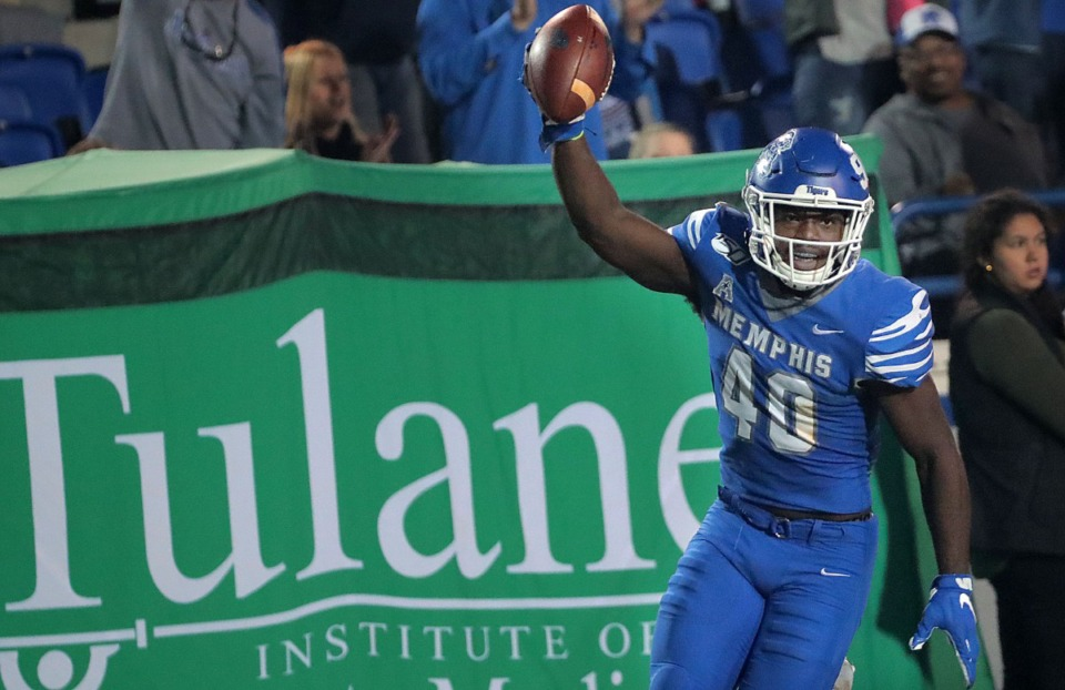 <strong>University of Memphis linebacker Thomas Pickens (40) celebrates after intercepting a Tulane pass during the Tiger's game on Oct. 19, 2019 against the Green Wave at Liberty Bowl Memorial Stadium in Memphis.</strong> (Jim Weber/Daily Memphian)
