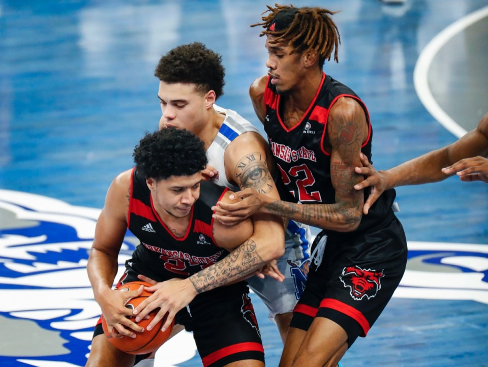 <strong>Lester Quinones (middle) applies pressure to Arkansas State guard Marquis Eaton (left) as Keyon Wesley (right) helps on the play on Dec. 2, 2020.</strong> (Mark Weber/The Daily Memphian)