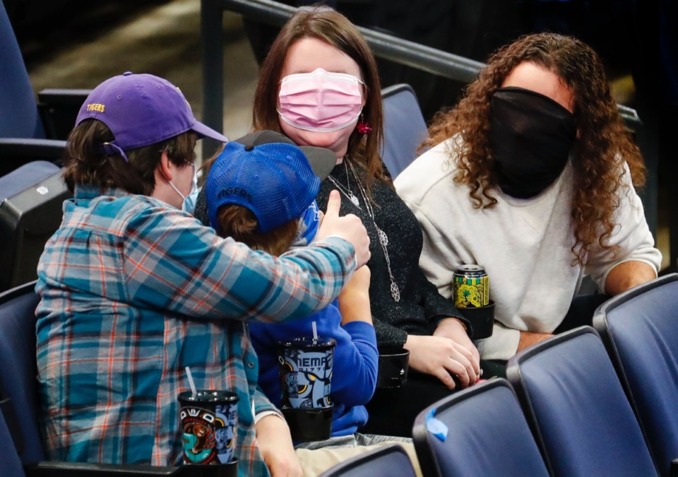 <strong>Memphis fans take a break from the game against Arkansas State to have a little fun with face masks on Dec. 2, 2020.</strong> (Mark Weber/The Daily Memphian)