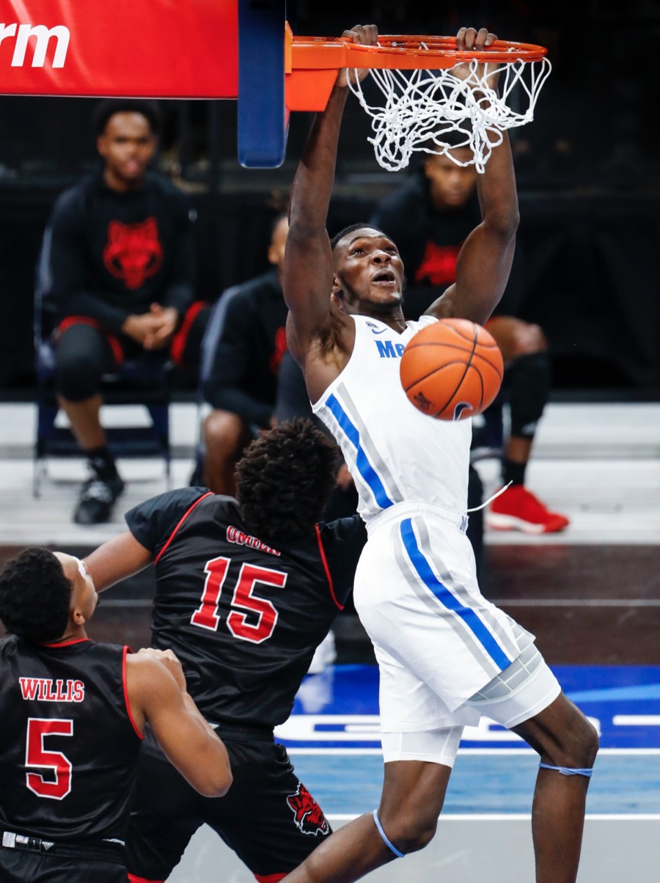 <strong>Memphis center Moussa Cisse (top) dunks over the Arkansas State defense on Wednesday, Dec. 2, 2020.</strong> (Mark Weber/The Daily Memphian)