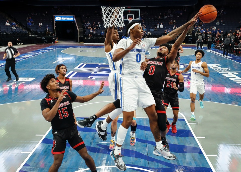 <strong>Memphis defender D.J. Jeffries (middle) blocks the shot from Arkansas State guard Caleb Fields (right) on Wednesday, Dec. 2, 2020.</strong> (Mark Weber/The Daily Memphian)