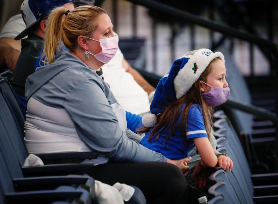 <strong>Masked fans cheer Memphis on against Arkansas State on Dec. 2, 2020.</strong> (Mark Weber/The Daily Memphian)