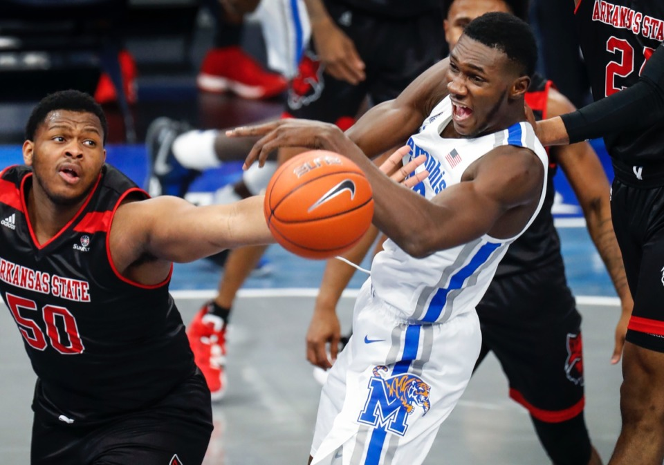 <strong>Memphis center Moussa Cisse (right) battles Arkansas State&rsquo;s Antwon Jackson (left) for a rebound.</strong> (Mark Weber/The Daily Memphian)